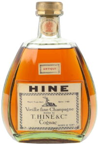 Neck label with the royal arms; HINE in bold black letters on top; 'Vieille fine champagne bottled by T. Hine & Co'; 24 FL OZS stated on the back (1960s)
