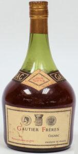 1909; gold coloured capsule