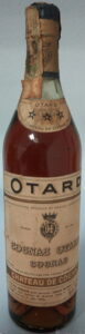 With a castle on the neck label and 'Chateau de Cognac' stated below the three stars; with a paper duty seal (est. 1950s)