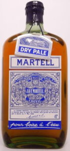 With a longer capsule over the spring cap; with a black label (1950s)