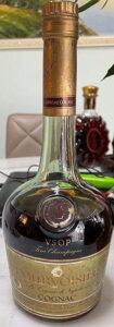Three lines of text below Cognac: 70cl Singapore import.