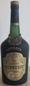 Napoleon on the shoulder (without accent). Napoleon stated on main label. Brownish label. Asian import.
